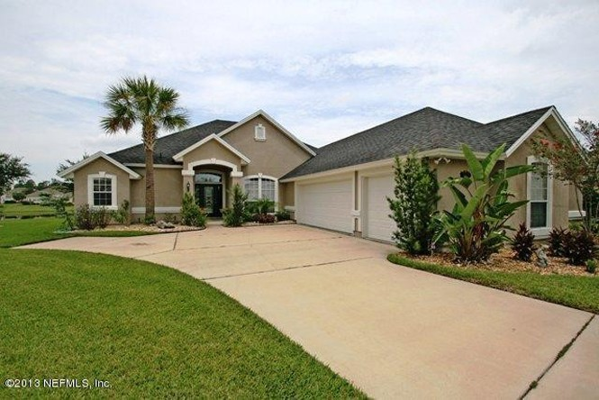 Contemporary Florida Styling in this 4/3, 2,600 feet home in Old Mill Branch