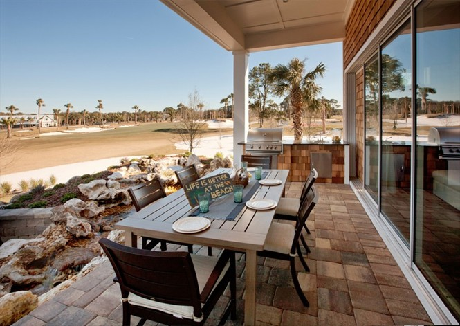 Many homes in Toll Brothers at Atlantic Country Club have golf course and water views.
