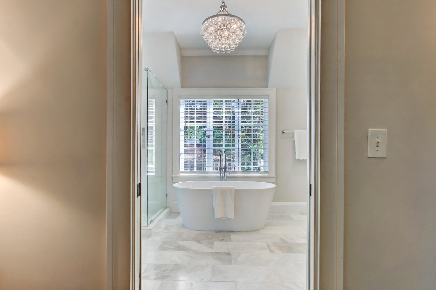 Master bathroom with large soaking tub and neutral colors