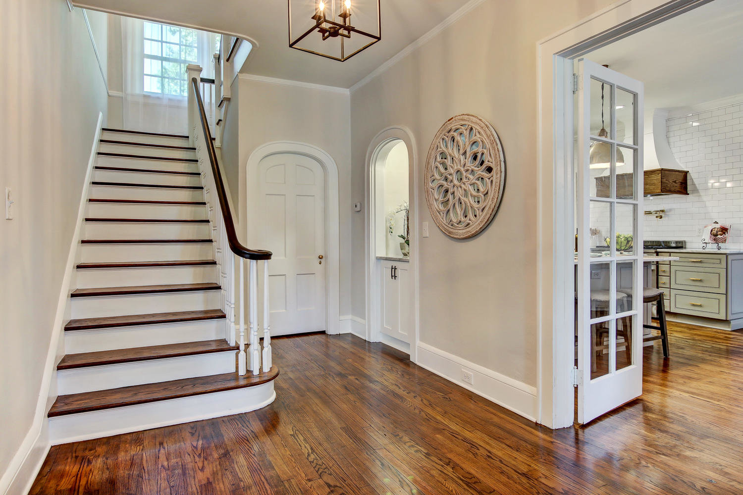 Interior foyer of 1524 Seminole Road in Jacksonville with views of kitchen and stairs