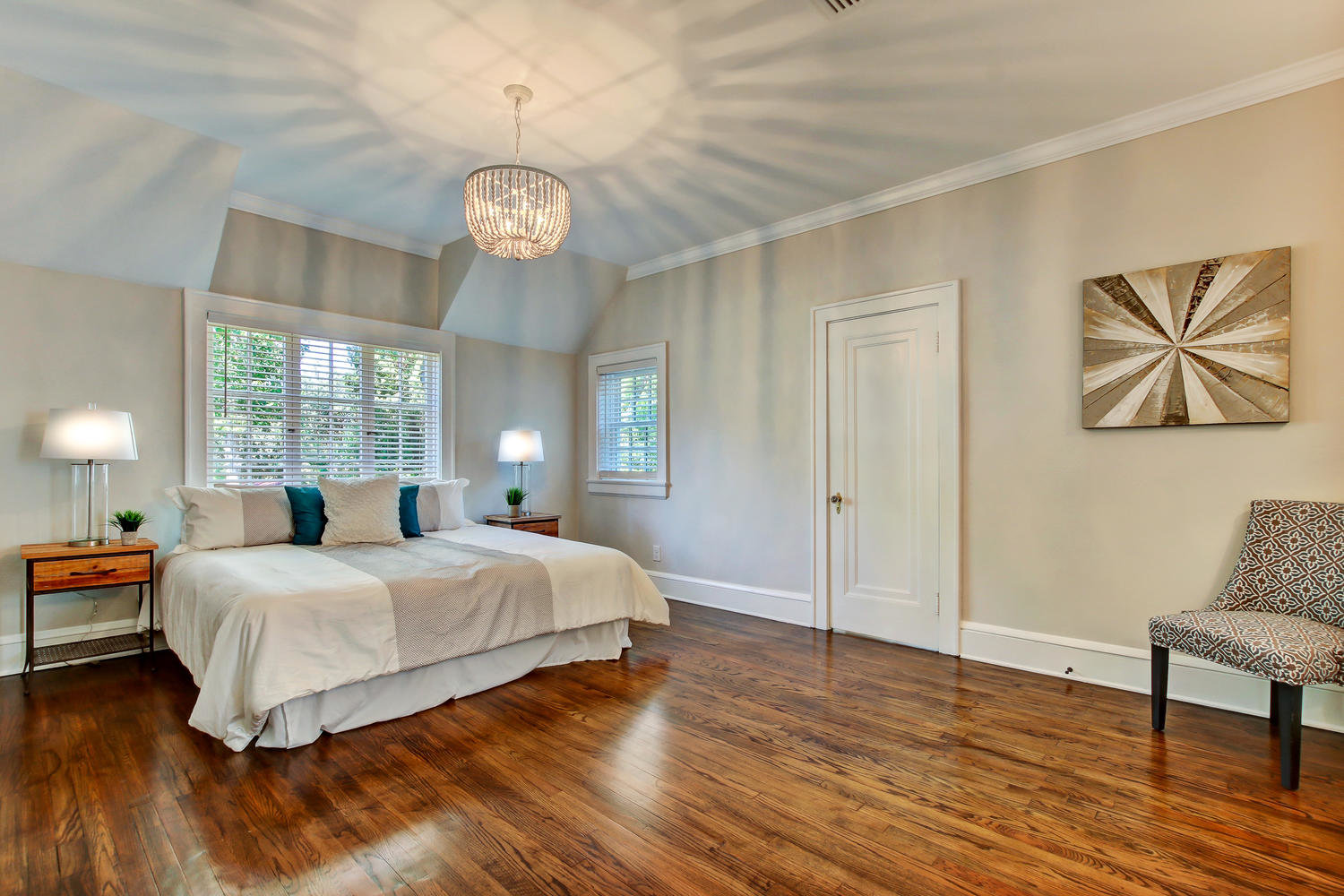 Master bedroom in Avondale home with original hardwood floors
