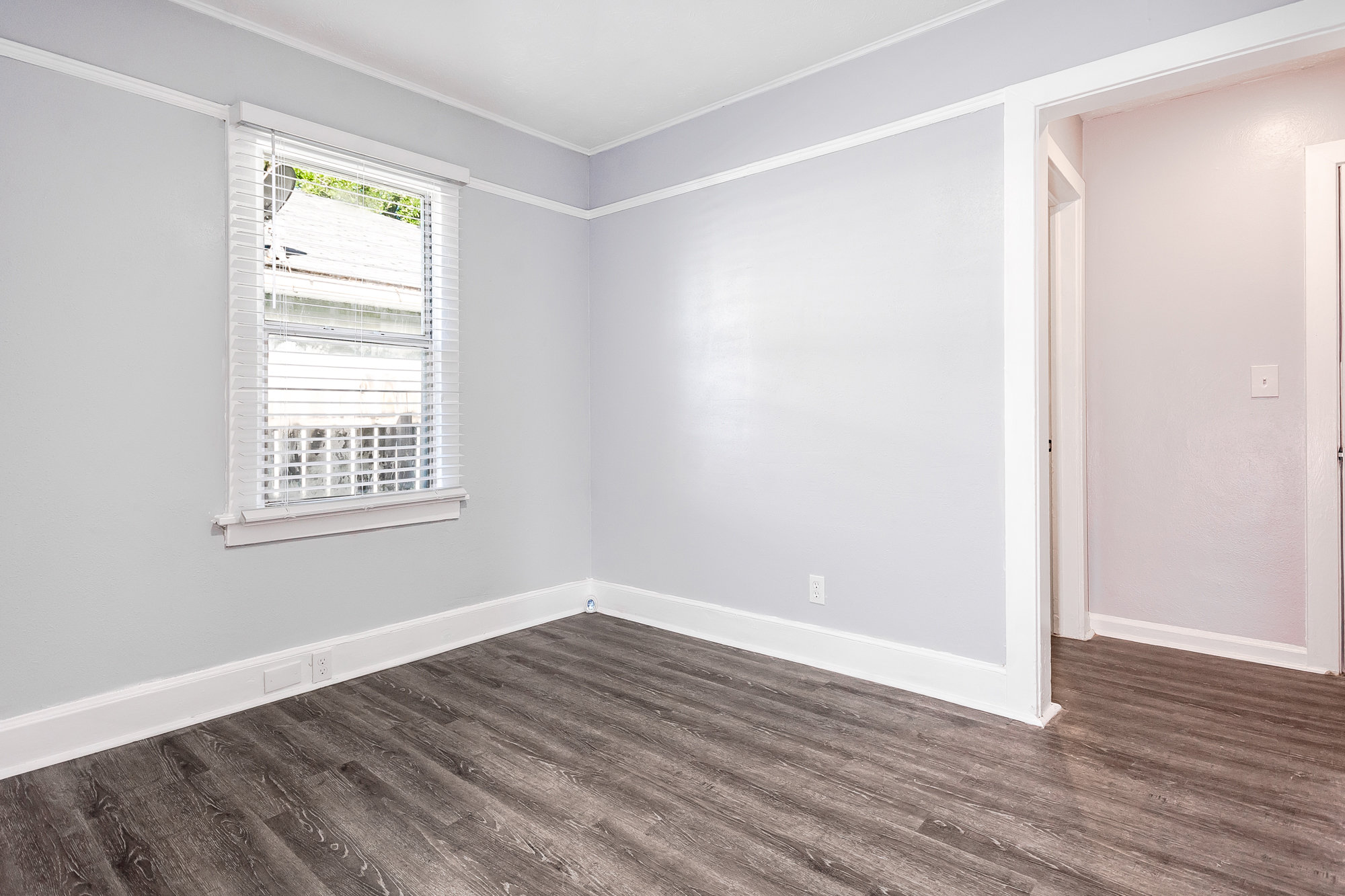 Bedroom with netural colors and updated floors