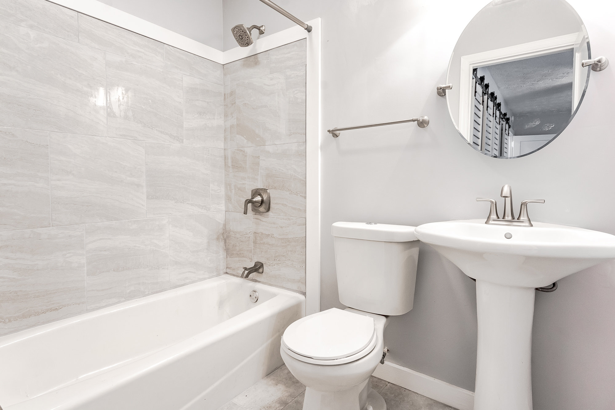 Updated bathroom with netural colors in Murray Hill home