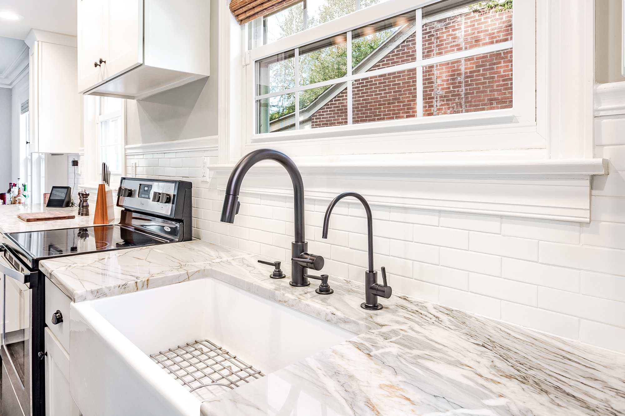 Elegant farmhouse sink and white granite countertops