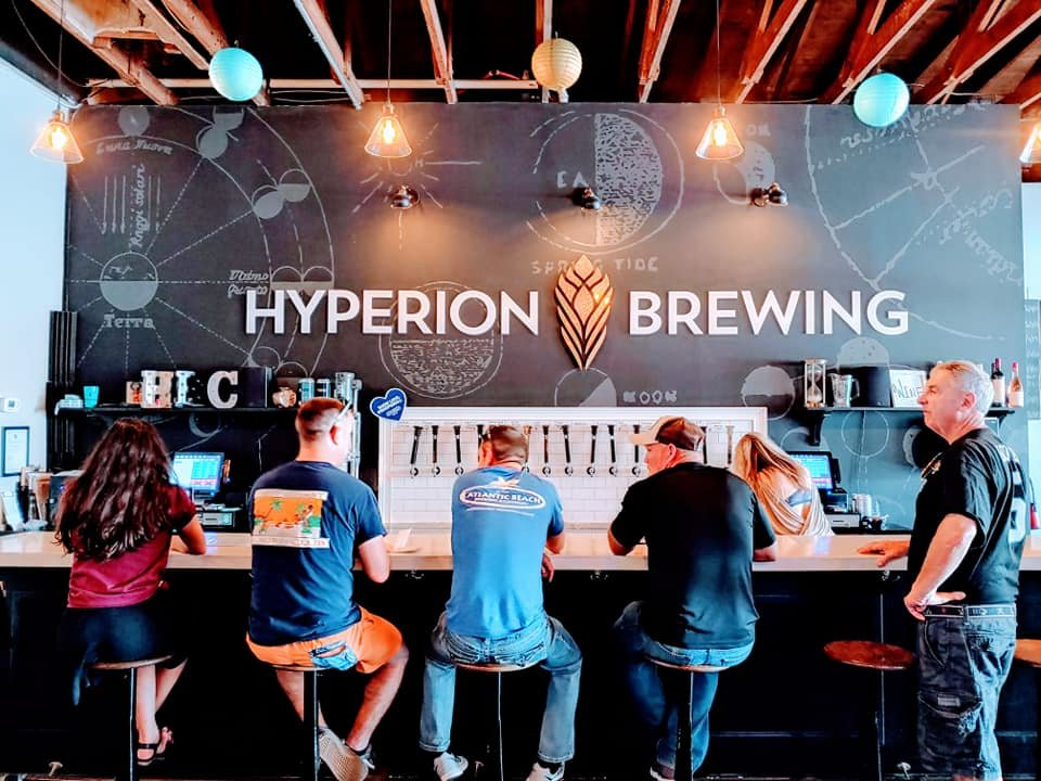 People sitting at the bar at Hyperion Brewing Company in Springfield Jacksonville